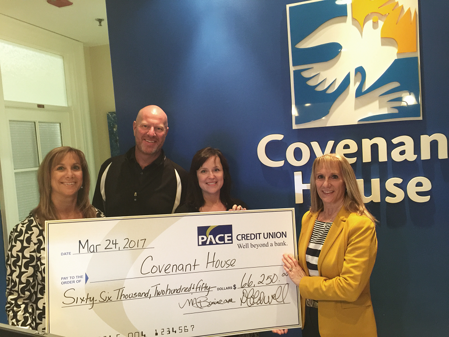 PACE presents cheque to Covenant house